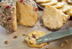 Cheese snack. Cheese and crackers on a cutting board royalty free stock image