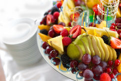 Cheese snacks and fruit snacks. On plate Royalty Free Stock Photo