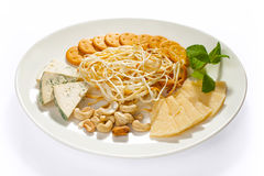 Cheese and snacks Stock Photos