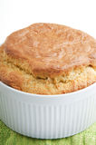 Cheese souffle. Closeup of a dish with a hot, fresh, baked cheese souffle.  White background Royalty Free Stock Images