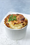 Cheese Souffle. On white lace over blue background Stock Image