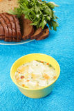 Cheese soup and bread with greens Royalty Free Stock Images