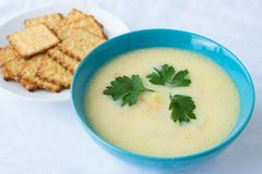 Cheese soup and crackers Stock Photo