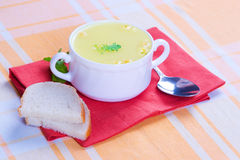 Cheese soup served. Cheese soup serves on a yellow tablecloth Stock Photos
