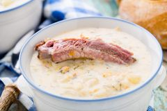 Cheese soup with smoked ribs Royalty Free Stock Photography