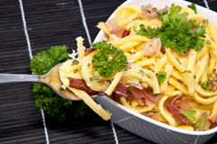 Cheese Spaetzle on black tablecloth Stock Photography