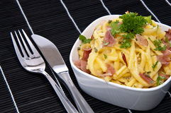 Cheese Spaetzle in a Bowl (on black) Royalty Free Stock Photography