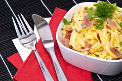 Cheese Spaetzle with cutlery (on black) Stock Images