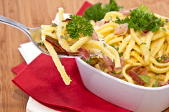 Cheese Spaetzle with portion on fork Royalty Free Stock Image