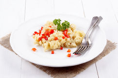 Cheese spaetzle with red bell pepper and parsley Stock Image
