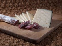 Cheese and spanish sausage Royalty Free Stock Images