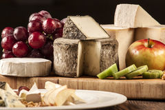 Cheese specialties on wood plate. Royalty Free Stock Photography