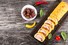 Cheese spicy meat Roll-Ups on cutting board,view from above Royalty Free Stock Photo