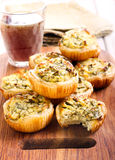Cheese and spinach mini pies Royalty Free Stock Photos