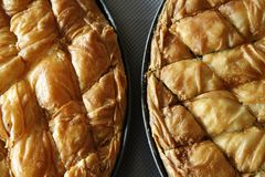 Cheese and spinach pie close up. Traditional greek Cheese pie and spinach pie in pan shot from above Stock Photos
