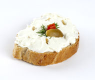 Cheese spread with olives on bread Stock Images