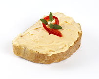 Cheese spread with pepper on bread Stock Photography