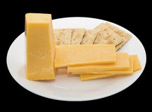 Cheese square salted crackers isolated black Royalty Free Stock Photos