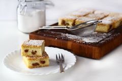 Cheese squares with raisin, cheese cake royalty free stock photos