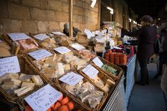 Free Cheese Stall With Shoppeers Customers At A Food Market In Cathedral Cloisters Showing People, Goods And Stalls Stock Image - 184746241