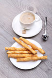 Cheese sticks and coffee Stock Images