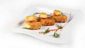 Cheese sticks fried with sesame. And decorated with dill Royalty Free Stock Photo