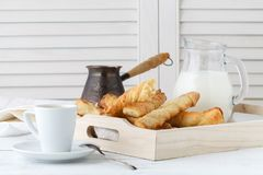 Cheese sticks with puff pastry on wooden tray. Delicious appetiz Stock Image
