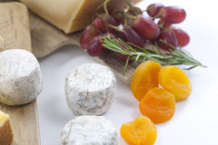 Cheese still life with fruit Royalty Free Stock Image