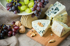 Cheese still life with red grapes stock photo