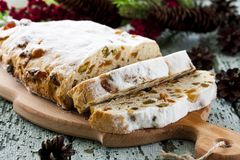 Cheese Stollen with dried fruit and pistachios. Traditional cheese Stollen with dried fruit and pistachios Stock Image