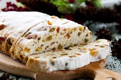 Cheese Stollen with dried fruit and pistachios. Traditional cheese Stollen with dried fruit and pistachios Stock Photography