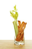 Cheese straws and celery Stock Photos