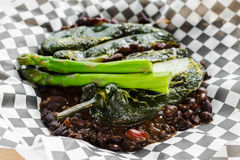 Cheese stuffed pasilla peppers and black bean chili Stock Photography