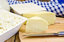 Cheese suluguni with curd and sour cream on board Royalty Free Stock Photography