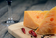 Cheese on the table with glass of wine Royalty Free Stock Photos