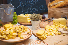 Cheese table - various types of cheese Royalty Free Stock Images