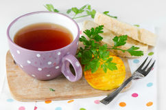 Cheese and tea cup Royalty Free Stock Photos