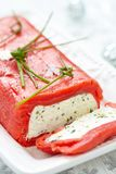 Cheese terrine wrapped with smoked salmon. Festive cheese terrine wrapped with smoked red salmon Stock Photo