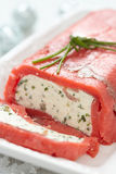 Cheese terrine wrapped with smoked salmon Stock Photography
