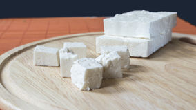 Cheese tiles and cubes Royalty Free Stock Photo