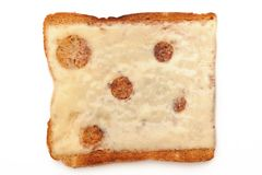 Cheese on toast. Photograpgh of cheese on toast taken from above, shot in studio and  on a white background Royalty Free Stock Images