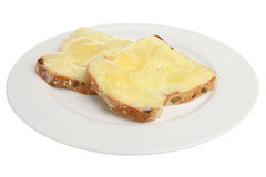 Cheese on Toast. Grilled mature cheddar cheese on wholemeal toast Royalty Free Stock Photo