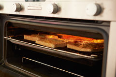 Cheese On Toast Being Grilled In Oven Stock Images
