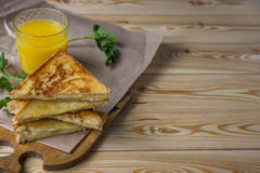 Cheese toasts for breakfast and orange juice in glass. Sandwich Stock Image