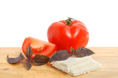 Cheese, tomato and basil Stock Images