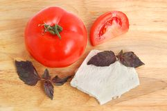 Cheese, tomato and basil Stock Photo