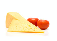Cheese and tomato isolated on white Stock Images