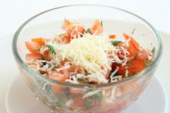 Cheese and tomato salad in a bowl. Cheese and  red  tomato in a transparent  bowl Stock Photo