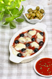Cheese, tomato sauce and black olives gratin Royalty Free Stock Images