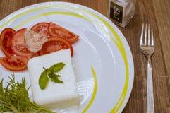 Cheese and tomato. Tuna on tomato Stock Photography